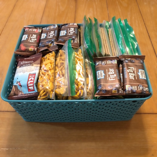 a basket of snack that are easy to grab and go