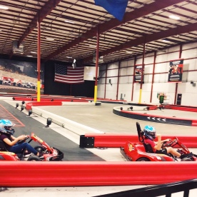 Conner and Alexis racing go-karts at autobahn indoor speedway