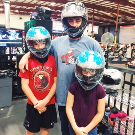 Aaron, Conner, and Alexis wearing helmets and ready to race at Autobahn indoor speedway