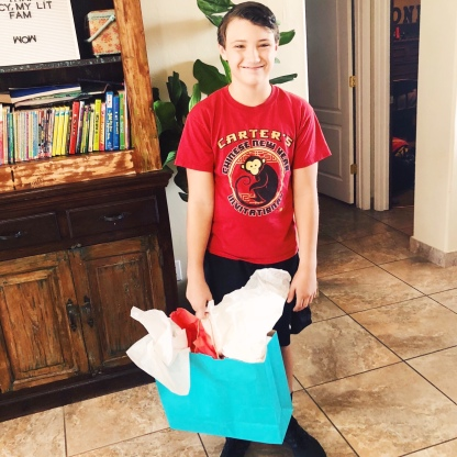 Conner holding a gift bag
