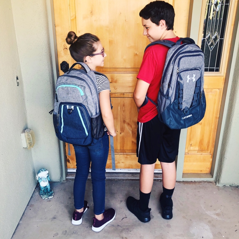 Conner and Alexis wearing their backpacks for the first day of school