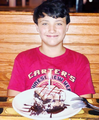 Conner with his birthday cake at Carrabba's italian grill